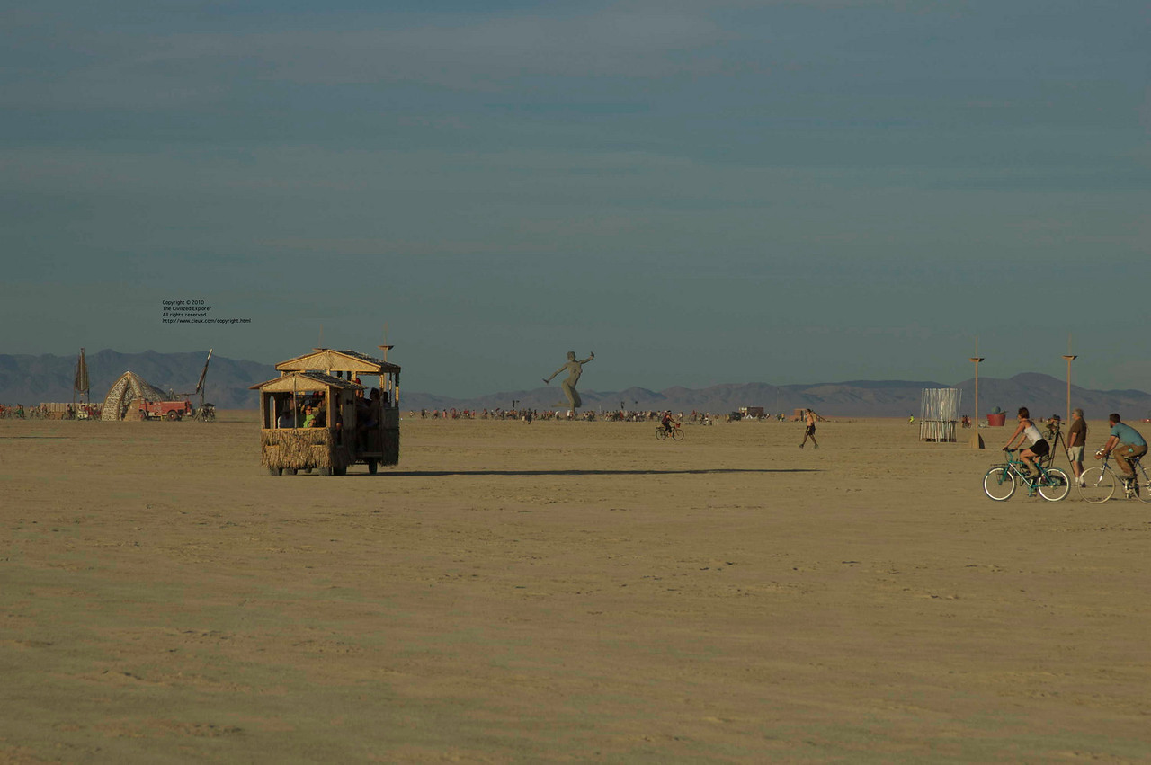 With Bliss Dance in the background, an art car trundles across the playa.