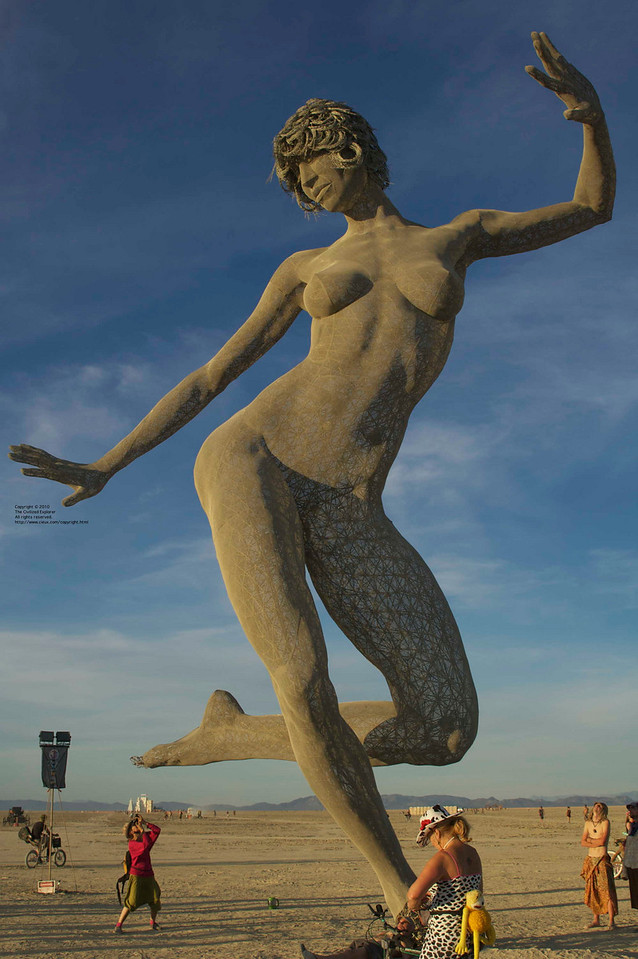 """Bliss Dance, by Marco Cochrane<br /> <a href=""""http://blissdance.org/"""">http://blissdance.org/</a><br /> This was one of the most popular pieces on the playa, and we have lots of photos and video of it. It is supported on one foot, welded to cross pieces which are buried in the playa. See the link to read about its construction."""