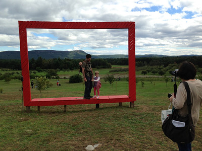 The Big Red Frame, by Eastmont Custom Framing, Easthampton.   People lined up to pose in it!
