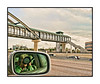 A quick shot from the window of our speeding car as we passed one of the rapid transit stations located along I-25.  My self portrait was an inadvertent by-product.