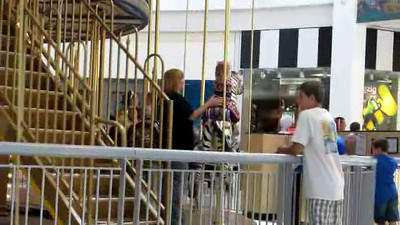 Ashley and Peyton ride the Carousel.