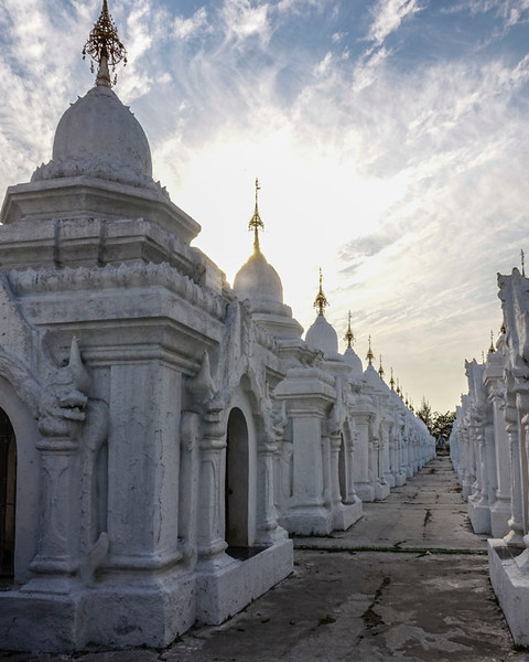 "KUTHODAW PAGODA. EACH OF THESE UNITS HOUSES A ""PAGE"" OF THE LARGEST BUDDHIST BOOK: 729 MARBLE SLAPS ENGRAVED WITH BUDDHIST SCRIPTURES."