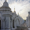 """KUTHODAW PAGODA. EACH OF THESE UNITS HOUSES A """"PAGE"""" OF THE LARGEST BUDDHIST BOOK: 729 MARBLE SLAPS ENGRAVED WITH BUDDHIST SCRIPTURES."""