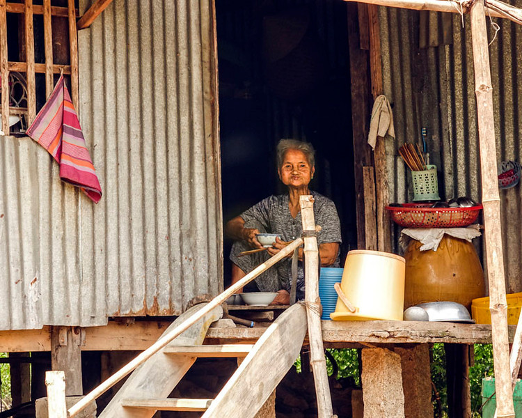 VIET CONG (FORMERLY) LADY IN HER VERY RURAL HOME. JUST ARRIVED IN VIETNAM.