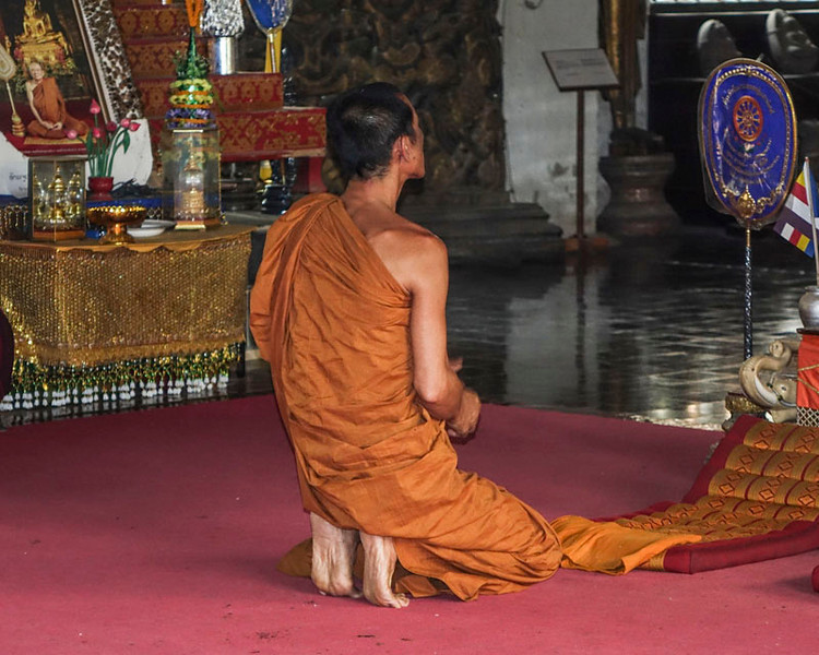 Monk praying in the monastery.
