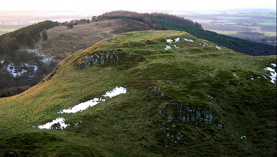Dunsinane Hill.  Macbeth shall never vanquish'd be until 	Great Birnam wood to high Dunsinane hill 	Shall come against him.  Macbeth did indeed have his castle here, the terraced ramparts obvious. The hill bears the scars of some hamfisted Victorian archeology. 3.40pm, 26/01/15