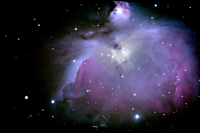 "M42 - Final image with processing taken March 20, 2007. 12"" LX200 Classic @ F6.3 Alt/Az mode tracking Unguided Stock Canon 300D  34 images of 25 seconds for 15 minutes of total exposure time Aligned and stacked in Imagesplus Pixel math, brightness scaling, and DDP in Imagesplus 5 sec exposure image layer mask applies in Photoshop to bring out the core stars. Curves applied in PS7. Unsharp mask applied."