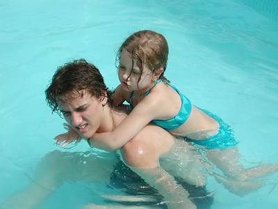 """Big brother """"Josh"""" gives sister """"Stormie"""" a piggy back ride in the pool at the Potillo Resort."""