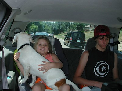 We begin the trip as all trips begin. My daughter Stormie holds her favorite dog, Snowball as my son - Josh looks on. Taken on the way to the dog sitter.