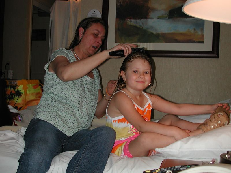 Staying at the hotel in New York for an evening before our departure from JFK Airport, the next morning.  Stormie gets her hair brushed.