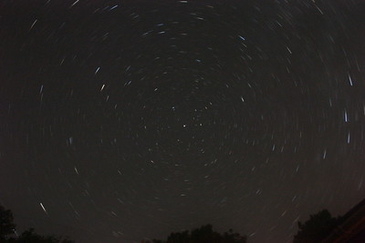 Star trails around the pole star, about 12 minutes I think - measure the angle if you want to know!