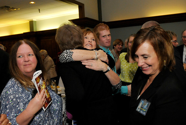 Attendees line up to congratulate Athena winner Stephanie Moran.