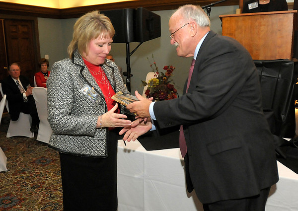 Marcy Fry receives her Community Shining Star award from The Herald Bulletin publisher Henry Bird during the Athena and Community Shining Star Awards Gala at the Anderson Country Club on Tuesday.