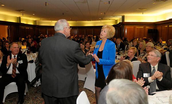Deanne Beard accepts her Community Shining Star award.