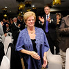 Don Knight |  The Herald Bulletin<br /> Sally DeVoe walks to the stage to accept the 2017 Athena during an awards dinner at the Anderson Country Club on Thursday. DeVoe has led the Madison County Community Foundation for over a decade.