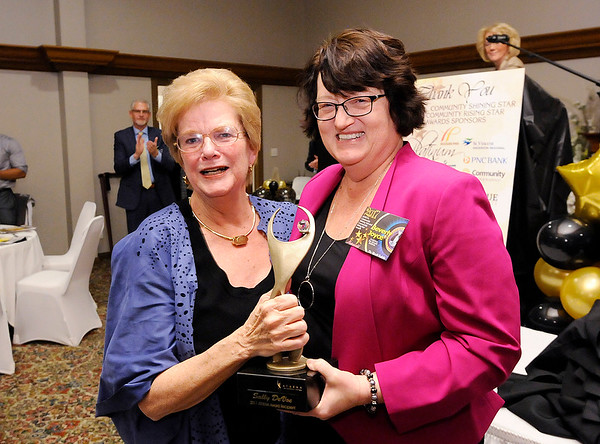 Don Knight    The Herald Bulletin<br /> Sally DeVoe receives her Athena award from The Herald Bulletin Publisher Beverly Joyce during the Athena awards dinner at the Anderson Country Club on Thursday.