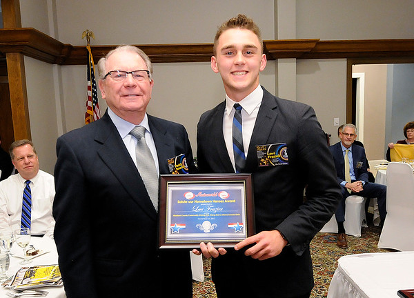 Don Knight |  The Herald Bulletin<br /> Levi Frazier received the Salute Our Hometown Heroes scholarship for the police department.