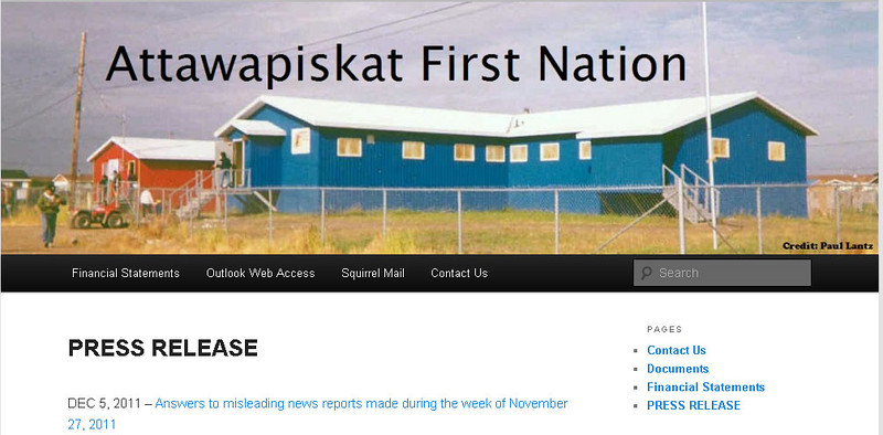 www.attawapiskat.org screen shot of top of home page retrieved 2011 December 11th. Includes image of band office by Paul Lantz. This screen shot used to illustrate fund raising coupon event on paullantz.com