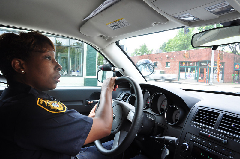 "12:45 pm - It's a quiet day for Cooper Young COACT (Comunity Action) police officer Lisa Brown who says community orriented policing brings officers and the public closer. ""Every day before work we pray we will end our day in the same condition we started it,"" she said."
