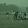 Junior high football practice in the rain
