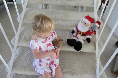 Sept. 3rd: Notice Ashley is holding Santa's reindeer.  A week ago she placed it on the steps to wait for Santa.  She thinks Santa comes down the stairs.
