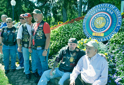 J.S.Carras/DIgitalfirstmedia.com  Vietnam Era Veterans Jack Clancy, of Albany and David Kieserman, of Ssaratoga sit with other veterans in front of a commemorative logo on Circular Street near Congress Park to remember the 50th anniversary of of the Vietnam War Friday, August 29, 2014 in Saratoga Springs, N.Y..