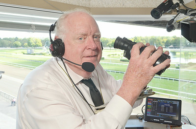 J.S.Carras/DIgitalfirstmedia.com  Track announcer Tom Durkin prepares for race card on Friday, August 29, 2014 at Saratoga Race Course in Saratoga Springs, N.Y..