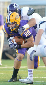 J.S.Carras/DIgitalfirstmedia.com  Holy Cross' Nick McBeath (43) takes down UAlbany receiver Brian Parker (80) during second quarter of college football action Saturday, August 30, 2014 at Bob Ford Field at UAlbany in Albany, N.Y..