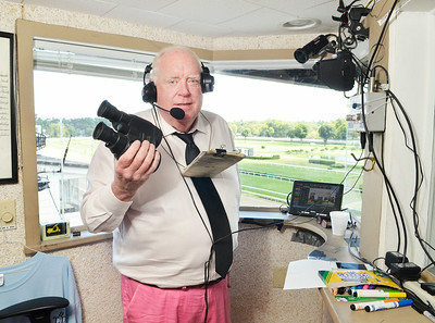 J.S.Carras/DIgitalfirstmedia.com  Track announcer Tom Durkin and his tools of his trade as prepares for race card on Friday, August 29, 2014 at Saratoga Race Course in Saratoga Springs, N.Y..