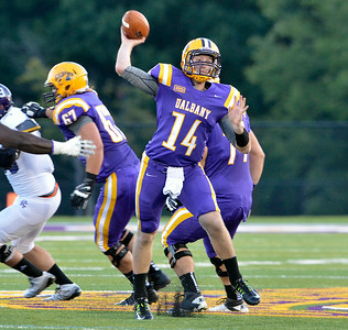 J.S.Carras/DIgitalfirstmedia.com  UAlbany quarterback Will Fiacchi (14) throws against Holy Cross during second quarter of college football action Saturday, August 30, 2014 at Bob Ford Field at UAlbany in Albany, N.Y..