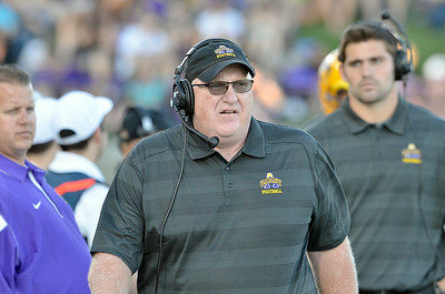 J.S.Carras/DIgitalfirstmedia.com  First year UAlbany coach Greg Gattuso walks sidelines against Holy Cross during first quarter of college football action Saturday, August 30, 2014 at Bob Ford Field at UAlbany in Albany, N.Y..