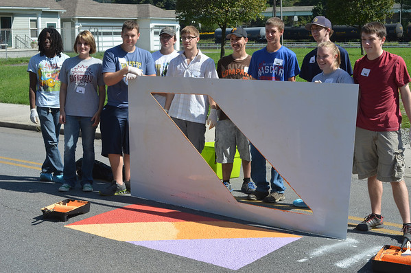 Nearly 100 volunteers from Pitt-Johnstown, local rotary clubs and a Mennonite volunteer group gathered to beautify the Somerset Street area through trash pickup, weed-pulling and stencils that promote awareness of cyclists.