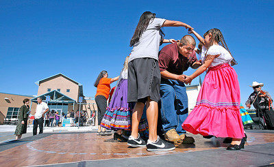 Martin Romero, center, and his daughter Anna romero, 7, perform in La March during the celebration of the opening of the new Rio Arriba Health Commons, a one-stop integrated health care center, on Aug. 25, 2010.             Luis Sanchez Saturno/ The New Mexican.