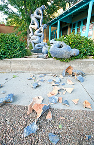"""A ceramic sculpture entitled """"Blue Gate"""" by artist Mark Chatterley lays shattered at about 7:00 p.m. in front of The Edge gallery on the corner of Canyon Road and Paseo de Peralta on Aug. 24, 2010.             Luis Sanchez Saturno/ The New Mexican."""