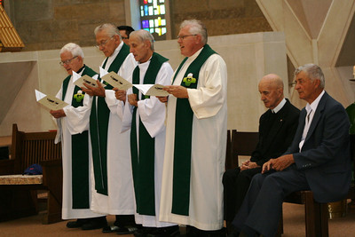The 2009 jubilarians.  On the far left you can see a chair with a Cubs hat on it.  Br. Jim Willis was to have celebrated his 60th year of vows but died shortly after the invitations were mailed.  A life-long Cubs fan, the hat was placed on the chair in his memory.