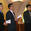 Son Ho, Luis Fernando Orozco Cardona and Joseph Vu hold the Rule of Life.