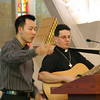 Frs. Vien Nguyen and Mark Mastin lead the closing song.