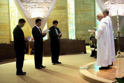 Son Ho, Luis Fernando Orozco Cardona and Joseph Vu prepare to enter the novitiate.
