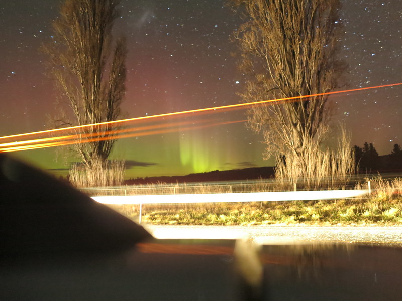 Aurora seen with passing truck and our car in the foreground