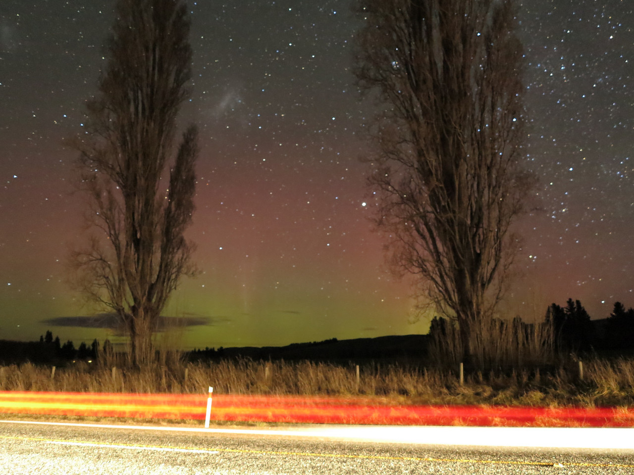Faded aurora seen with passing car