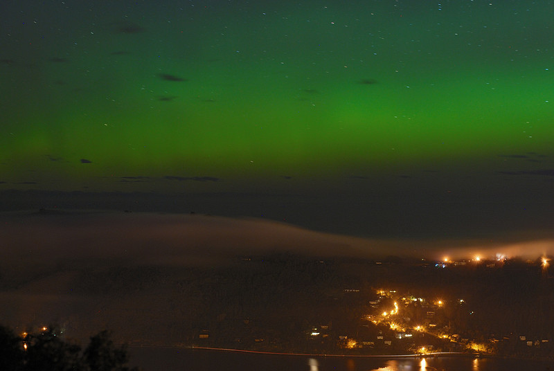 Otago Penisula sleeps under a layer of fog, while the aurora australis shines in the sky above. Signal Hill, Dunedin, 16 July 2012, 1:13am