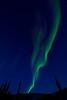 jet exhaust illuminated by light from aurora