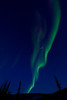 jet exhaust illuminated by light from aurora