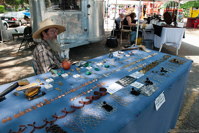 A jeweler with his products at a SoCo marketplace.
