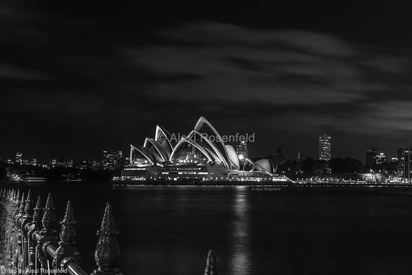 8. The famous Sydney Opera House taken from below the Sydney Harbour Bridge – black and white photograph.