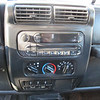 Factory radio.   CD player does not work.  AM/FM does work.  Speakers in dash and rollbar have been upgraded.   I have a nice Alpine head unit and the trim bezel that was going to replace this, just didnt get around to installing it.   If you want the jeep and want the Alpine, its yours along with the jeep.