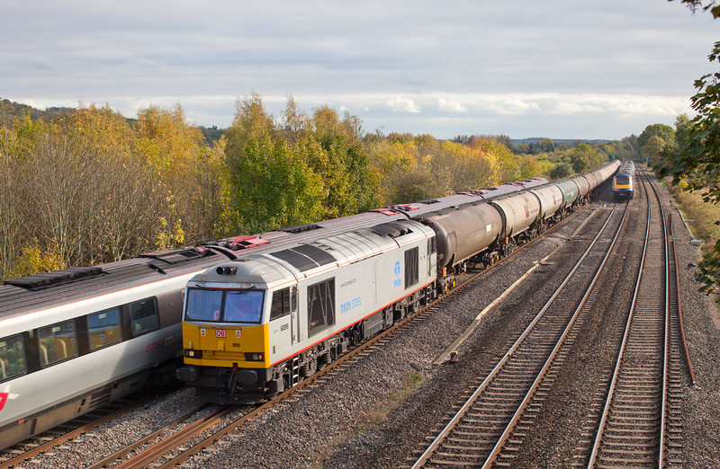 Tata Steel 60099 approaches Lower Basildon on the GWML with the 6E55 13.35 Theale-Lindsey Empty Murco Oil tanks. 21.10.11