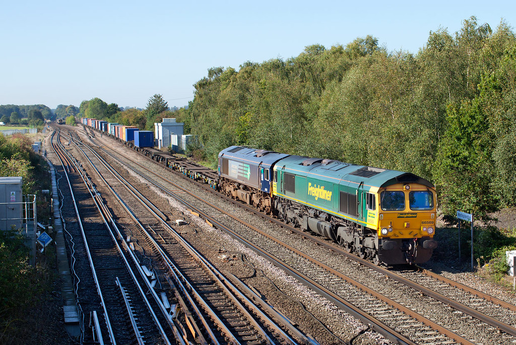 66569 & DRS 'hire in' 66428 double head the 4M28 09.32 Southampton-Birch Coppice past Worting Junction. 28.9.11
