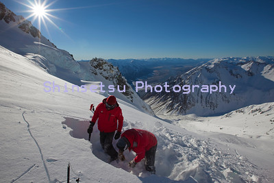 Guides digging a snow profile, Southern  Alps NZ (MR)