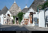 P11.14 Trullo from Southern Italy (Cone-shaped house, white, with thatched roof)<br /> <br /> Choice 7 of 13<br /> <br /> B6AAP5 Souvenir shops in Trullo houses; Alberobello, province of Bari, region of Puglia, southern Italy. Image shot 2006. Exact date unknown.